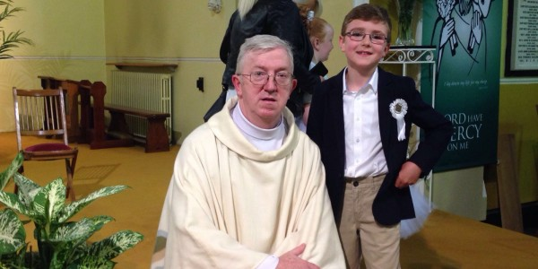 Fr. Fergal with one of the children